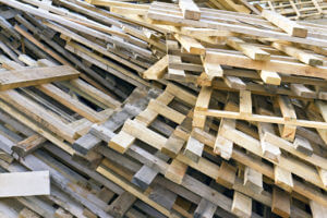 Piled into a heap of wooden pallets