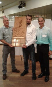 Clayton-Miller-Stuart-Isaascon-and-Donnie-Isaacson-of-PalletOne-accept-their-award-e1508246870558-600×1000